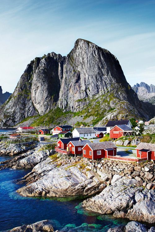 Fishermen's huts (rorbuer) along the sea in the village of Reine in the Lofoten…