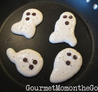 Ghostly Pancakes for Halloween with chocolate chips for eyes and mouth