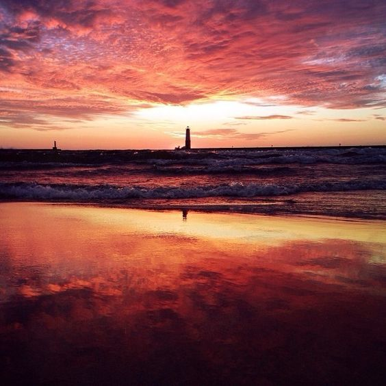 What a cool reflection shot taken at Frankfort Beach in Frankfort, MI: http://www.michigan.org/city/frankfort/