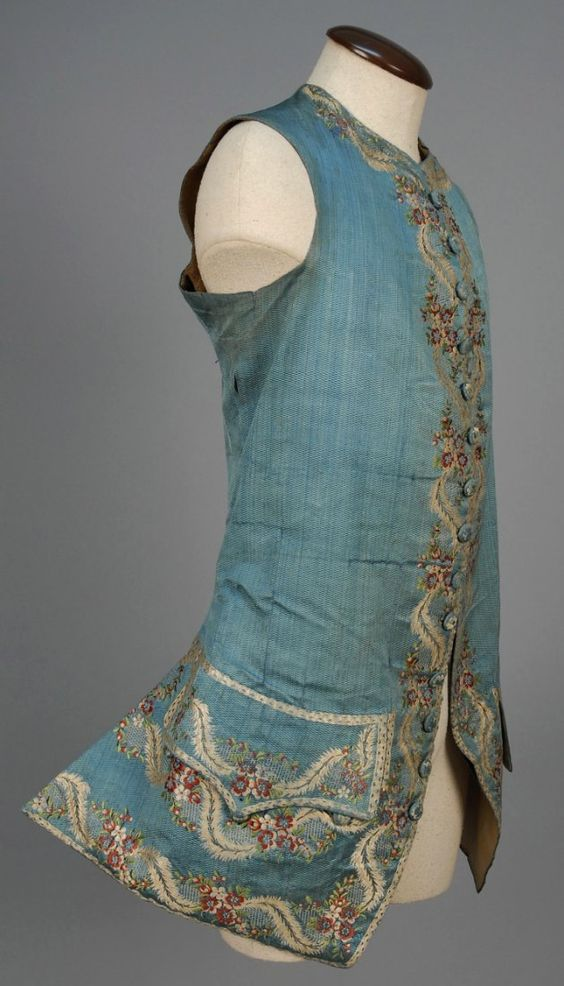 Waistcoat, France, 1760-1775. Blue patterned weave silk, delicately embroidered with a polychrome silk floral, silk and linen lining.