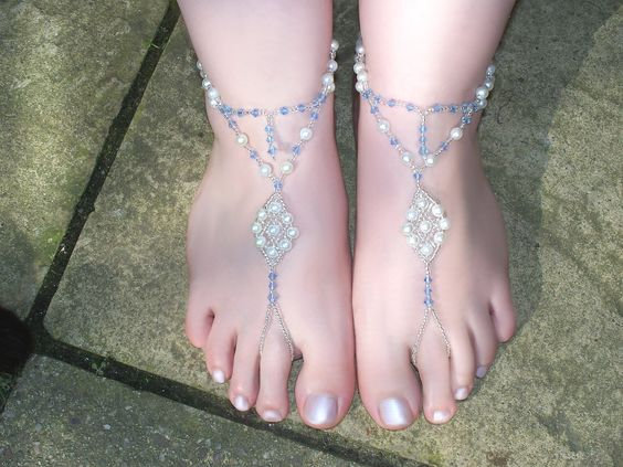 http://www.etsy.com/listing/96777316/pair-of-pale-blue-and-white-pearl-and