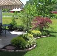 landscaping around patios - Bing Images Read More at:  space-gardens.blogspot.com                                                                                                                                                      More