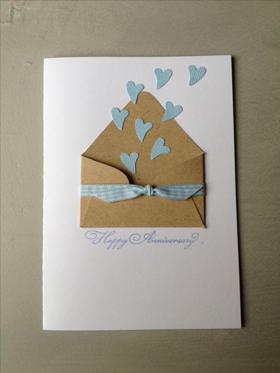 Great little anniversary card with a kraft paper envelope wrapped in ribbon with little hearts escaping