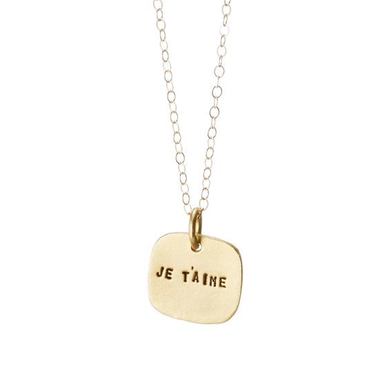 """Speak from your heart with this gold-plated charm embossed with Je t'aime—""""I love you"""" in French."""