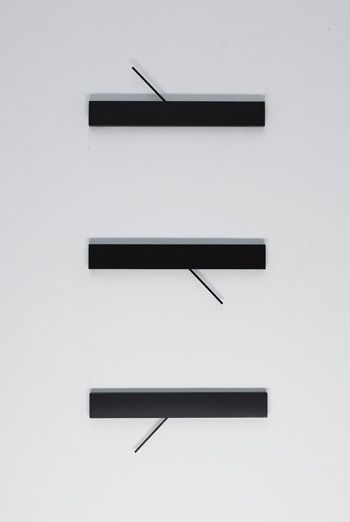 """Minimal """"Units of Time"""" clock by Rene Schwolow. Each piece ticks a different unit of measure: hours, minutes and seconds."""