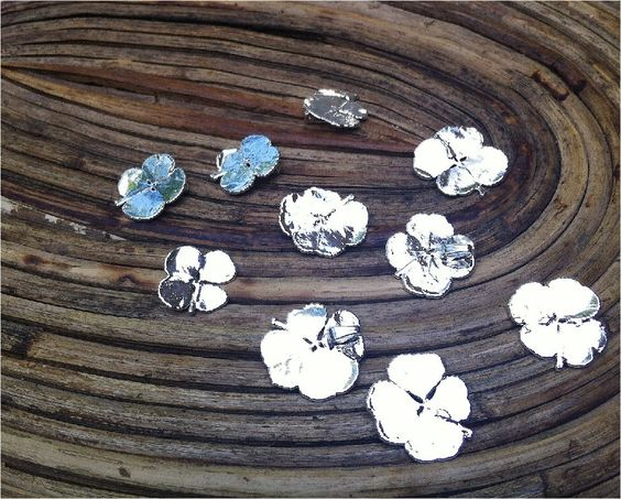 A field of Four Leaf Clovers Dipped in Silver  Woodsmith on Etsy