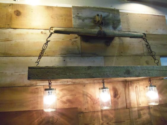 Reclaimed barn beam and antique horse yoke chandelier for Rustic barn light fixtures