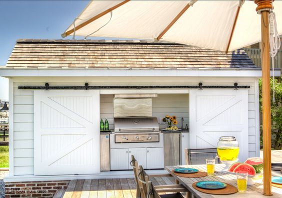 Outdoor Living Areas. Outdoor living area ideas. Isn't this the best shed you've seen? I am loving the idea of transforming a shed into an outdoor kitchen. Everything is kept organized and protected. #OutdoorAreas #OutdoorLivingAreas