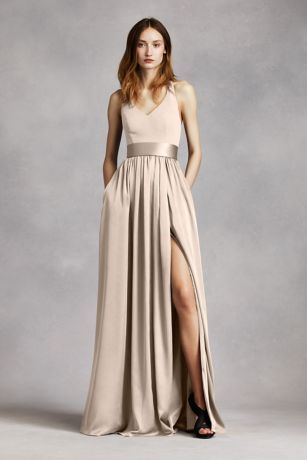 An exquisite gown that is perfect for a wedding party or any special event!  V-neck halter gown with matte crepe bodice features bow detail at back.  Long soft charmeuse skirt withmiddle slit and trapunto-stitched satin sash finishes off the look.  Sizes 0-26.  Fully lined. Back zip. Imported crepe/matte/charmeuse. Dry clean only.