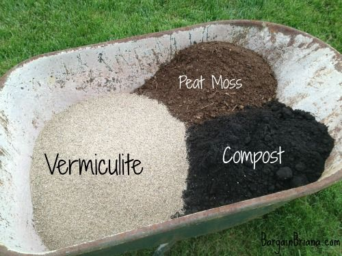 raised garden beds soil mixing in wheelbarrow {Raised Bed Gardening Part 2} Putting Together the Soil