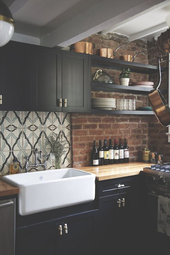 Really similar to what I'm going for - farmer sink with the black cabinets just extend the cupboards to the ceiling and add a stone backsplash