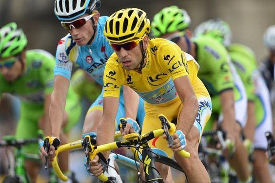 Tour de France 2014 - Stage 21: Évry - Paris Champs-Élysées - Vincenzo Nibali (Astana) races into Paris in yellow