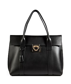 Detailed in ultra soft black leather, Salvatore Ferragamo's luxe tote is an iconic choice for all four seasons #Stylebop