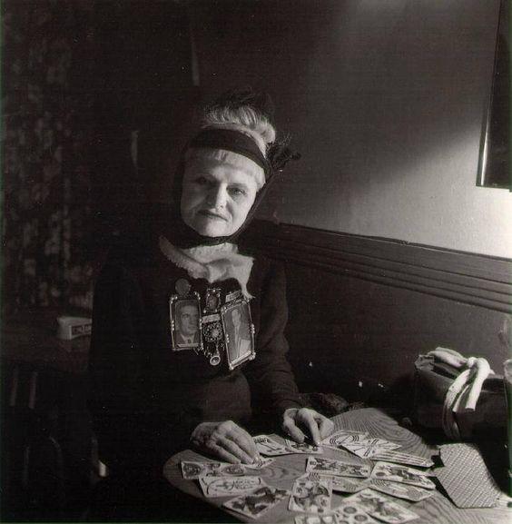 The Fortune Teller  by Robert Doisneau  Paris, 1951 using the French Marseille tarot deck