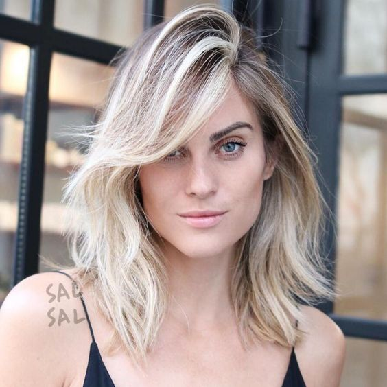 Medium Layered Hairstyle With Side Bangs