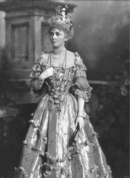 Mrs. Willie James (nee Evelyn Elizabeth Forbes). She was the daughter of Sir Charles Forbes, a Scottish aristocrat, and married the immensely wealthy William Dodge James and set about entertaining the Prince of Wales in the lavish, opulent fashion he loved. Pictured here in her costume designed by Lucile for the Duchess of Devonshire's 1897 ball.