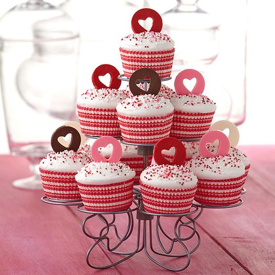 Say how much you love your family and friends without saying a word by making these Valentine?s Day cupcakes. The candy heart circles are made using Candy Melts candy and Wilton Cut-Outs Fondant Cutters.: