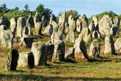 Megaliths of Carnac amidst the beautiful French country side--rows of megaliths and only guesses as to what they mean