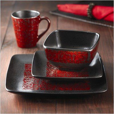 Red and black earthenware plate set. More dining decor ideas @BrightNest Blog.