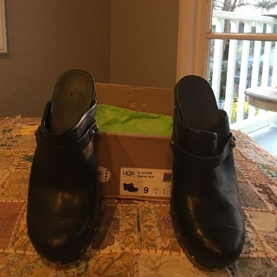 """Ugg Black Clogs Awesome Ugg black leather clogs with fur on inside from toes to 1/2 way up foot, so comfy heel is 4"""". Shoes are in excellent condition UGG Shoes Mules & Clogs"""