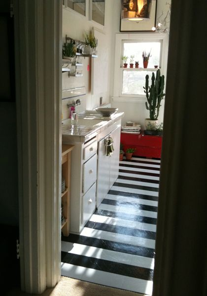 Black and white floor in a small kitchen-- would look great with green or blue and white in our kitchen or maybe both. Striped stripes painted stripes floor