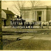The Carnegie Library with a Petoskey Brewing Company wagon and team in front of it.