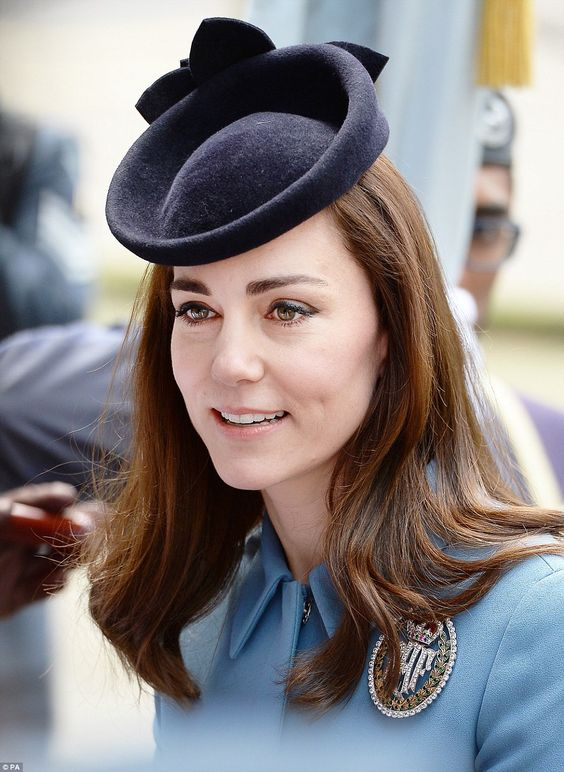 Princess charming: Kate was all smiles at today's event as she wore her RAF brooch proudly: