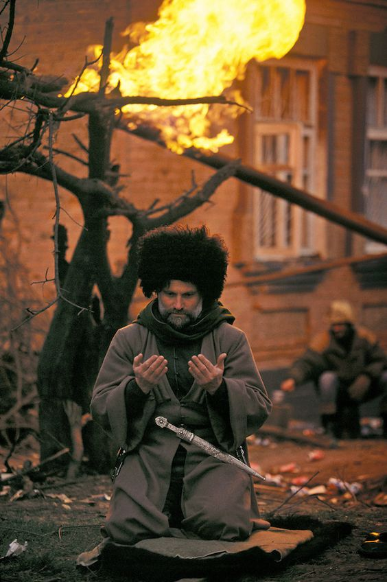 Chechnya during the first war. Chechen civilian rebel praying near the front line. (January, 1995)