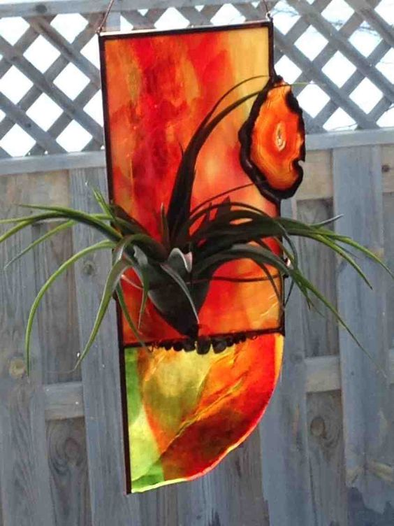 Stained glass sun catcher with an agate, Tillandsia and a piece of head glass
