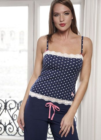 Pretty camisole and pant pyjama set made from fair trade cotton. Polka dot print camisole with contrast lace, bow, and butterfly motif details. Matching full length trousers with contrast tie and single pocket with butterfly motif. If you would like to purchase this item, please click here http://bit.ly/w7njZT for more information.
