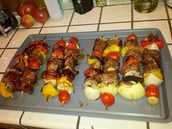 Kebabs. Steak, bell pepper, onion, cherry tomatoes, portobello ...