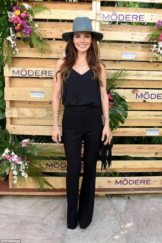 Simply chic: Taking a different style approach was Ali Landry, who core a simple and chic all-black ensemble