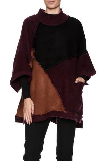 Colorblockoversized poncho with 3/4 sleeves, side pockets, mock neck and exposed stitch detailing.