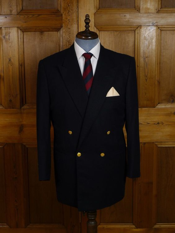 Savile Row Bespoke Navy Blue D/B Wool Blazer. Welsh & Jefferies of Savile Row, fully canvassed construction, luxury worsted cloth, 4/4 working cuff buttons, jetted hip pockets, Gold buttons with raised 'Fleur de Lys', luxury red satin lining with sailing ship motif, unvented.