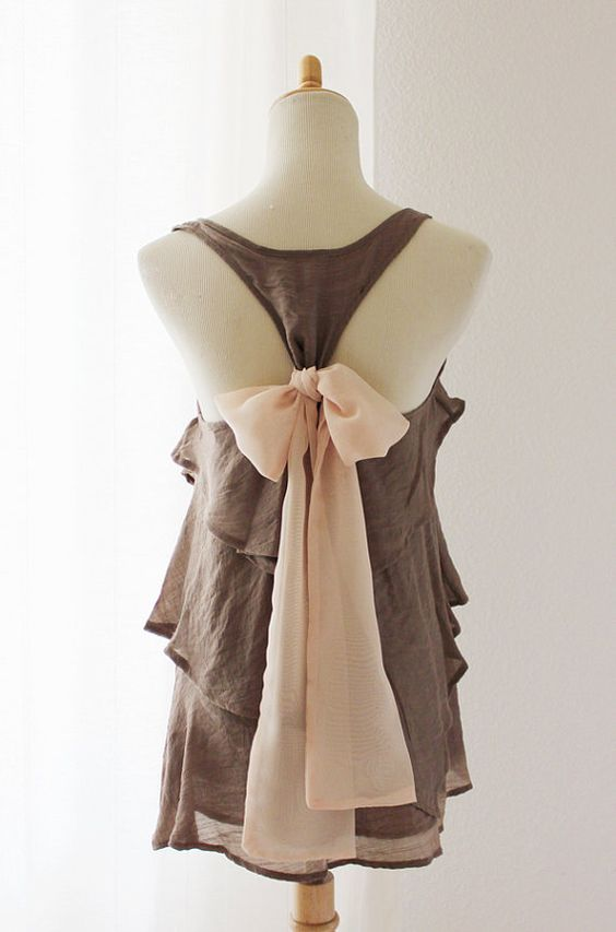 Scarf tied in a bow around a razor back  tank.