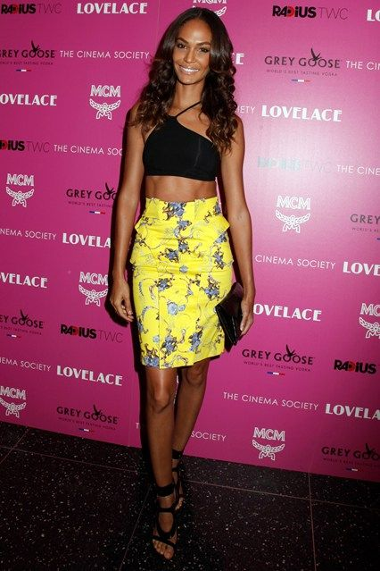 Joan Smalls in Helmut Lang top with Altuzarra skirt, Tom Ford sandals and carried a Givenchy clutch.