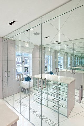 Walk-in closet using mirrors as cabinet doors #mirror #closet #storage #organization #allenrothCloset #allenAndRothCloset #closetShelves