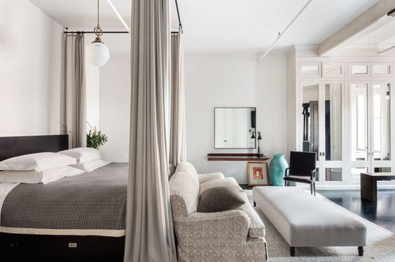 Luxurious and chic bedroom in Meg Ryan's Soho loft with industrial farmhouse style decor.