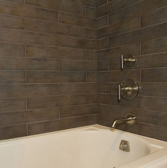 Daltile 39 s timber glen in espresso on the shower walls as seen on extreme makeover home edition Best tile for shower walls