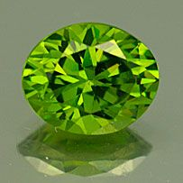 Demantoid is the green gemstone variety of the mineral andradite, a member of the garnet group of minerals. Andradite is a calcium- and iron-rich garnet.