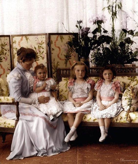 From left to right: Empress Alexandra Feodorovna holding Maria, Olga and Tatiana. 1900.