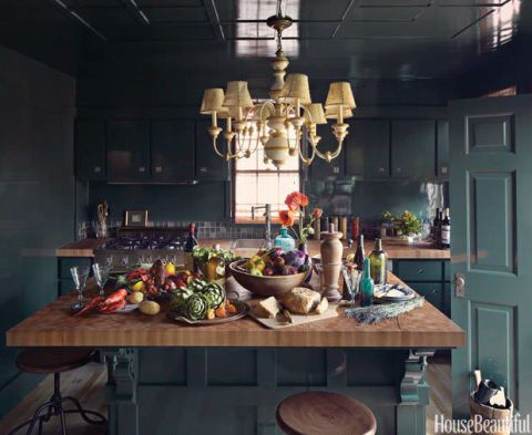 """""""Olive greens will be popular in 2015—I just did a kitchen with olive cabinets and it looks wonderful. The shade is warm, organic, and neutral for almost any other color you pair with it."""" -Capella Kincheloe As seen here in Kristin Hein and Philip Cozzi's Provincetown, Massachusetts kitchen."""