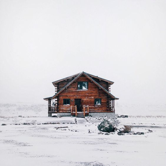 wooden cabin in the snow