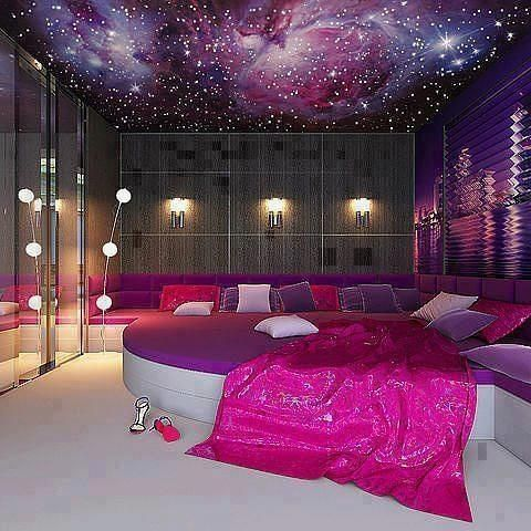 I live the rich purple and galaxy theme to this room. I also love the wall mural of I think New York, that's gorgeous