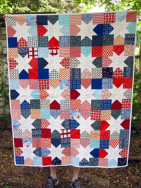 I love bright colours with white but usually there is too much white for a child's quilt. This would hide some of the stains!: