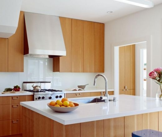 Vertical grain fir cabinets white tops and glass splash