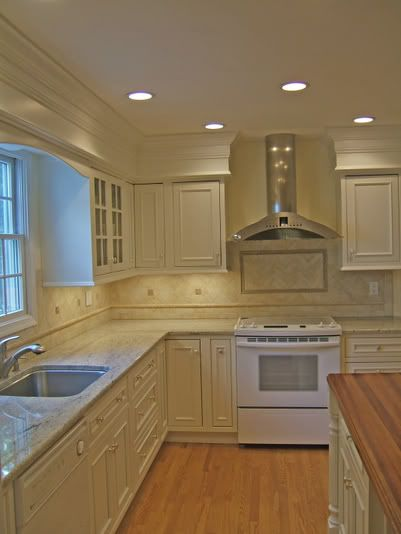 Add trim to soffits so they blend in paint cabinets white for Adding crown molding to existing kitchen cabinets