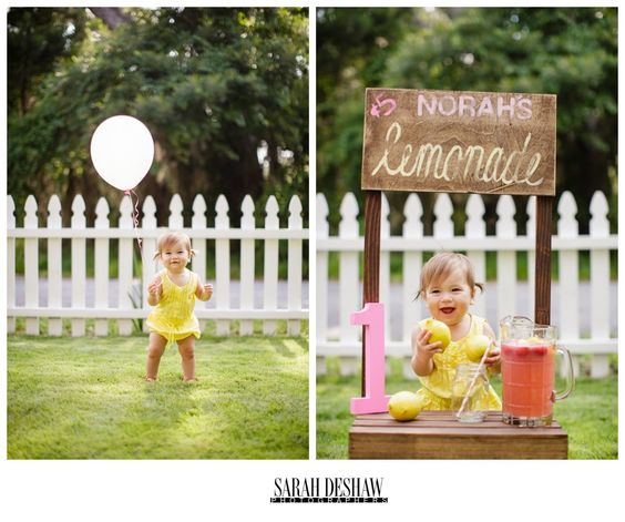 Norah's first birthday!   Toddler pigtails, pink balloons, and a tiny Lemonade stand to boot! #yellowromper #toddler #toddlerbirthday #firstbirthdayideas #pigtails #balloon #kidswithballoons  Sarah DeShaw Photographers » photographing weddings and engagements in the golden isles and everywhere else