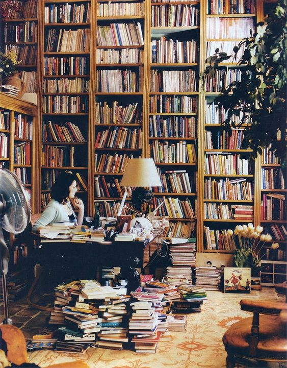 British cookbook author Nigella Lawson in her cookbook library in her London house. EA. Nigella Lawson's book in our library collection: http://catalog.lioninc.org/search~S29?/aLawson%2C+Nigella/alawson+nigella/1%2C1%2C9%2CB/exact&FF=alawson+nigella+1960&1%2C-1%2C/indexsort=r