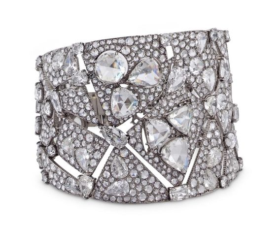 Designed as a tapering openwork cuff, composed of abstract angular sections pavé-set with rose-, circular- and pear-shaped diamonds, accented with large triangular and round and heart-shaped rose-cut diamonds connected by fancy-cut stones, mounted in white gold, signed Carnet, 2014. Total diamond weight 48.17 carats.